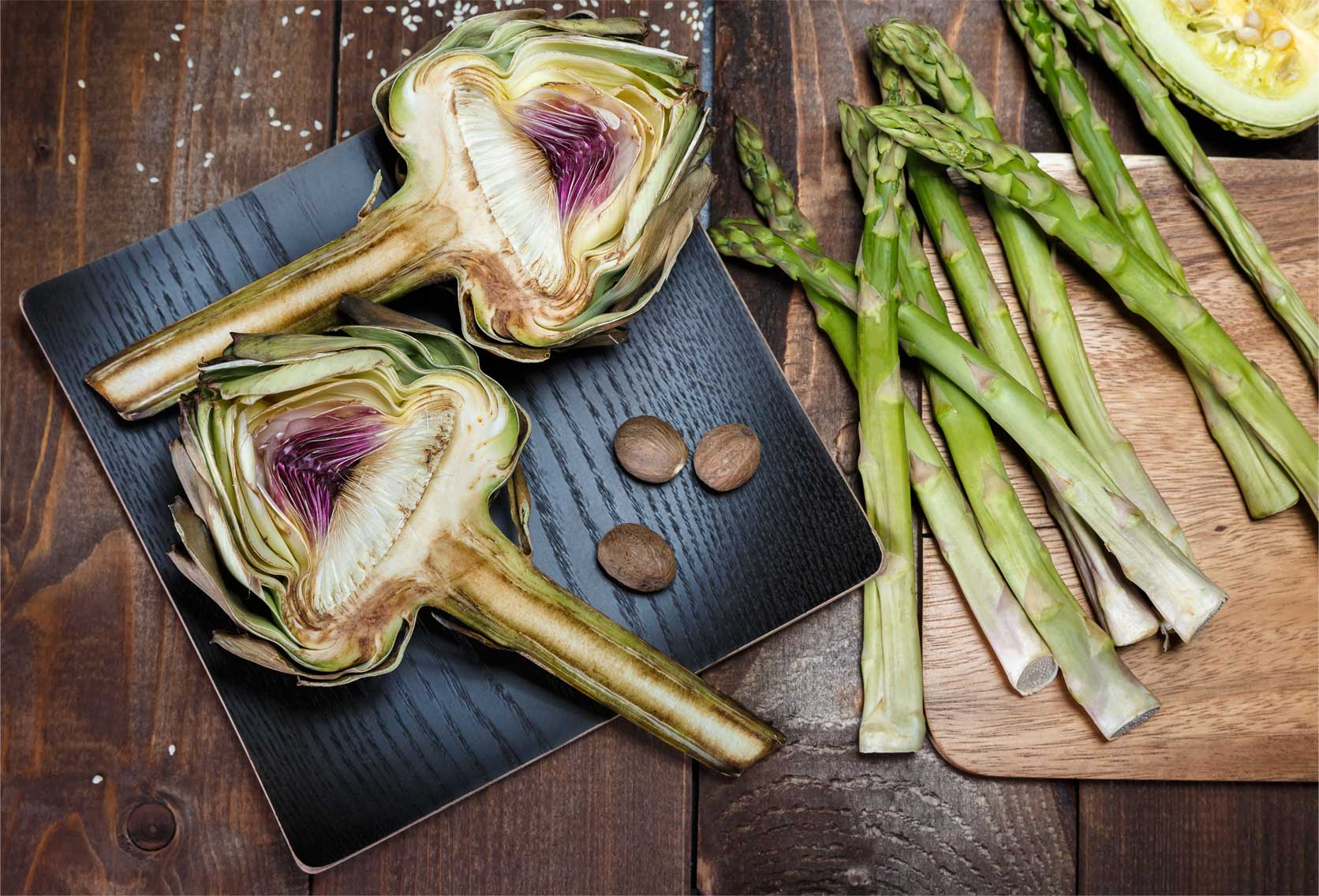 Beautiful fresh artichoke and asparagus being prepared for grilling
